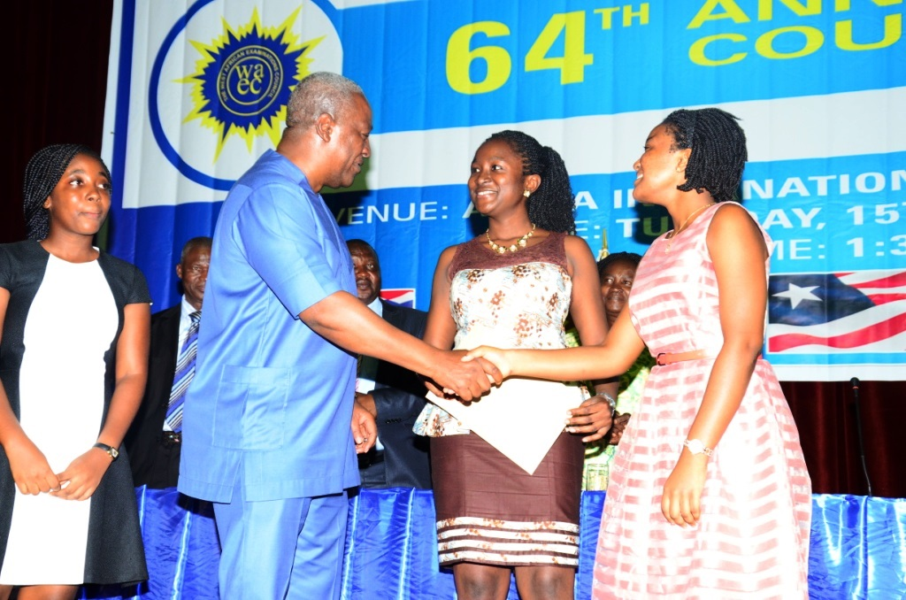 The President of Ghana, H. E. John Dramani Mahama  congratulates the three winners of WAEC Excellence Awards